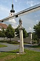 Pillory Geras reflected in bus stop by Lisa Holzer, Geras 02.jpg