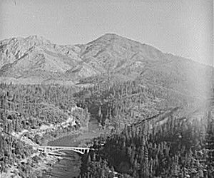 Shasta Dam - The Pit River Valley, now under Shasta Lake, in 1941. The bridge visible near the bottom once carried U.S. Route 99 before it was replaced by the Pit River Bridge (from the deck of which this photo was taken).