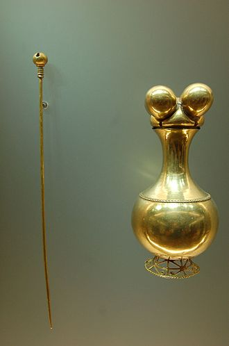 Mineral industry of Colombia - Poporo Quimbaya and pestle. Phytomorphic (fruit-shaped) lime container, gold, 300 BC - 1000 AD