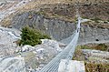 Porters on hanging bridge - Annapurna Circuit, Nepal - panoramio.jpg