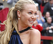 Actress Portia De Rossi smiling on the red carpet.