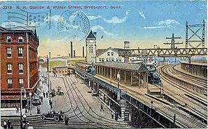 Bridgeport station (Connecticut) - View of station and Water Street, 1919 postcard.