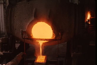 Metallurgy - Casting; pouring molten gold into an ingot.