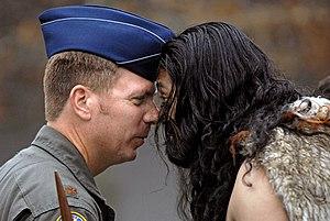 Pōwhiri - An American airman and a Māori man exchange a hongi during a pōwhiri.