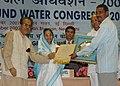 Pratibha Devisingh Patil presenting the National Water Award, 2007 to Shri Popat Pawar from Hiware Bazar Gram Panchayat, District Ahmednagar, Maharashtra at the 'National Ground Water Congress-2007', in New Delhi.jpg