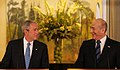 President George W. Bush listens as Prime Minister Ehud Olmert of Israel commends him.jpg