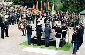 United States presidential election in Virginia, 1984 - Away from the campaign trail, Reagan (center, far left frame) attends the interment ceremony for the Vietnam Era serviceman, at the Tomb of the Unknowns, Arlington National Cemetery, Virginia. May 28, 1984.