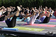 A Group Of People Practicing Yoga In 2012