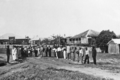 Queensland State Archives 5738 Hon J C Peterson Home Secretary and party with residents of Mona Mona June 1931.png