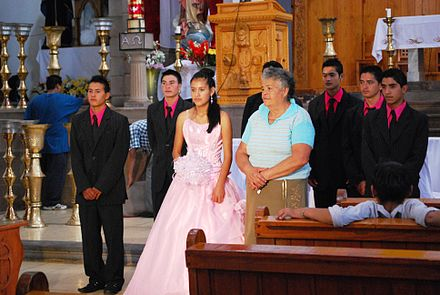 A Mexican quinceanera after mass in church. QuinceaneraSanFranValleBravo.JPG