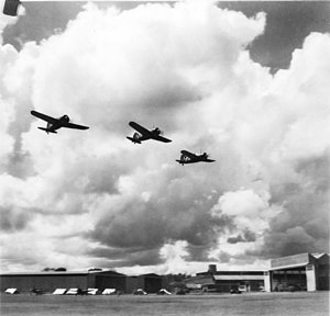 No. 21 Squadron RAAF - Brewster Buffalo aircraft of No. 21 Squadron flying over a Malayan airfield.