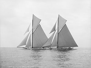 Black and white photograph of two racing yacht under full sail