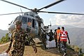 Relief material being off-loaded from an Indian Air Force (IAF) MI-17 V5 helicopter which landed at a very small helipad, at Chautara following a recent massive earthquake in Nepal.jpg