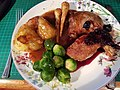 Roast Duck Breast & Leg with cherry sauce, roast parsnips, potatoes, sprouts and gravy. (45566092424).jpg
