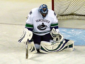 Butterfly style - Roberto Luongo of the Vancouver Canucks in 2009, using the butterfly style of goaltending by dropping to his knees and flaring his legs outward