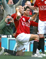Ferdinand celebrating a goal with teammate Cristiano Ronaldo.