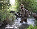 Royal Marine from 42 Commando Crosses a Ditch on Patrol in Afghanistan MOD 45153166.jpg