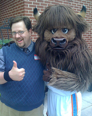 "Rumble the Bison - ""Rumble the Bison"" (at right) with a fan."