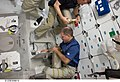 S125-E-006610 - John Grunsfeld and Gregory C. Johnson work with lithium hydroxide canisters on Atlantis during STS-125.jpg