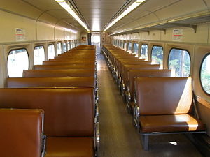 "Budd Silverliner - Interior of a Budd Silverliner showing the leatherette decor applied to cars 259, 269, 9012 and 9015 in place of the standard ""Ketchup and Mustard"" styling."