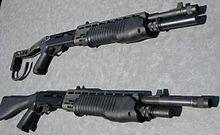 Two shotguns—the top one with a folding stock and the bottom one with a fixed stock