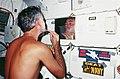 STS-41-D Mullane shaving.jpg