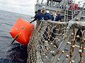 Sailors place target in water aboard USS Fitzgerald. (9191410065).jpg