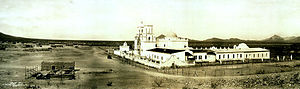 Jacal - Southern Arizona's San Xavier del Bac in 1913. Tohono O'odham jacals can be seen in front of the mission, many of which are still used today.