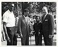 Satch Sanders of the Boston Celtics, Judge Elwood S. McKenney, and Police Commissioner Edmund McNamara pose with a girl holding basket ball trophies (13561444133).jpg