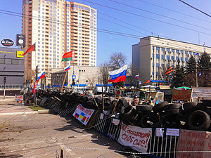 Flag of the Russian Soviet Federative Socialist Republic - Pro-Russia protesters occupied the Security Service of Ukraine building in Luhansk with the flag of the Russian SFSR, seen from the left.