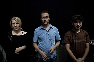 Seefeel - Members of Seefeel in 2010. From left to right: Sarah Peacock, Mark Clifford and Iida Kazuhisa.