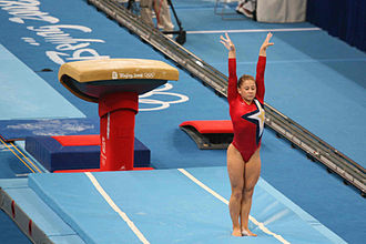 United States at the 2008 Summer Olympics - Shawn Johnson competes on vault during the team qualification.