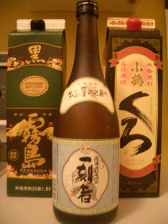Shōchū - A bottle and two cartons of Japanese shōchū