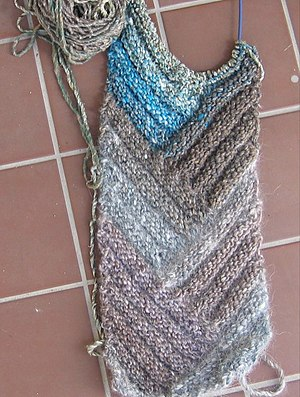 Short row (knitting) - A ribbed scarf hand-knit with a pattern that uses short rows.