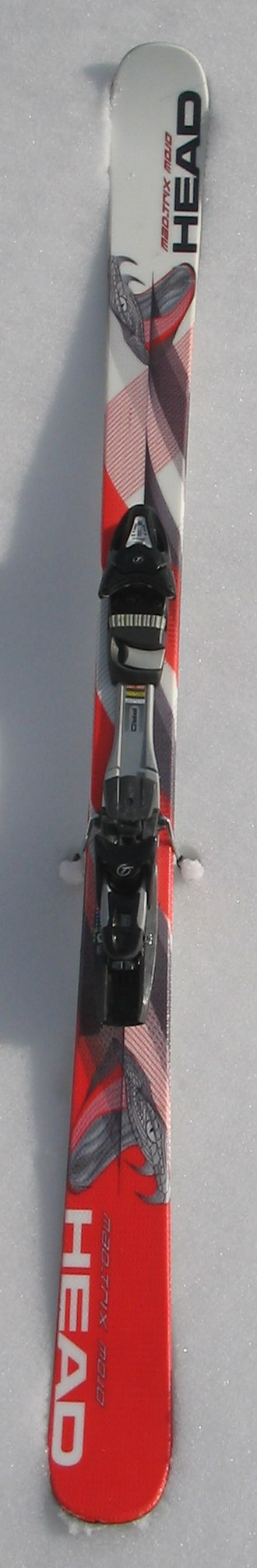 Ski -  A shaped alpine ski with relatively little sidecut and classic camber:  the tip and tail touch the snow while the midsection is in the air.