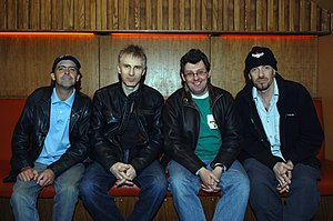 Stiff Little Fingers - Current lineup. Left to right: guitarist Ian McCallum, drummer Steve Grantley, frontman Jake Burns, and bassist Ali McMordie.