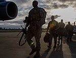 Soldiers board plane for EDRE 140930-A-BX700-065.jpg