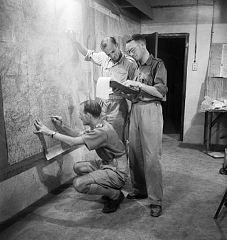 Lascaris War Rooms - Image: Staff officers plotting troop positions during the invasion of Sicily on a wall map in the underground operations room at Malta, 9 July 1943. NA4094