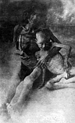 Starved Armenian woman with her son in Syrian desert.jpg