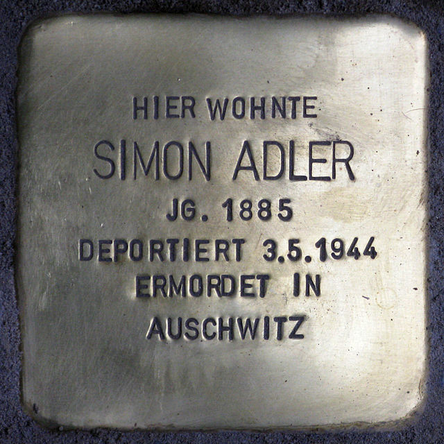 Photo of Simon Adler brass plaque