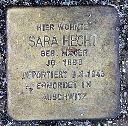 Photo of Sara Hecht brass plaque