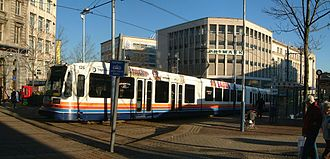 Sheffield Supertram - Siemens-Duewag Supertram 125 leaving Castle Square tram stop, on the Purple Route to Meadowhall Interchange