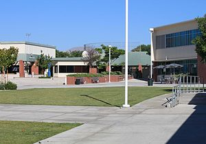 Taft College - The central quad in 2012. The Student Center building contains the cafeteria and testing center, with the baseball field in the background. At right is the administration/library building.