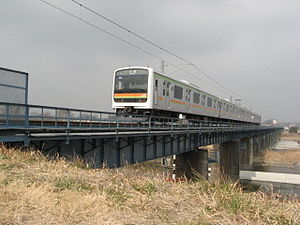 Hachikō Line - 209 series EMU crossing the Tama River, February 2007