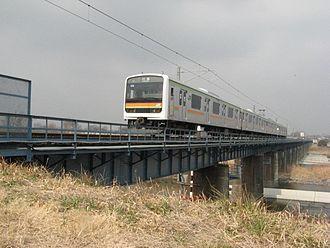 Hachikō Line - 209 series EMU crossing the Tama River, February 2007