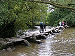 Tarr Steps a prehistoric clapper bridge across the River Barle in the Exmoor National Park.
