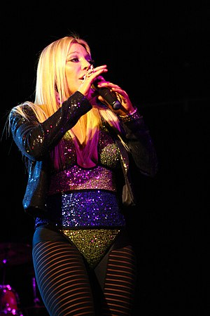 Leotard - Singer Taylor Dayne wears a sparkly leotard-inspired costume during her 2011 Australian tour