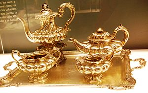 Mexican tea culture - Silver and gold tea set on display at the Franz Mayer Museum in Mexico City.