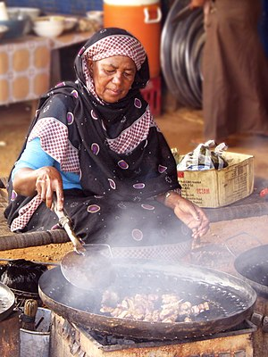 Sudanese cuisine - A woman cooking in Sudan
