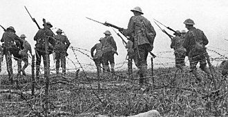War film - Staged scene of British troops advancing through barbed wire from The Battle of the Somme, 1916